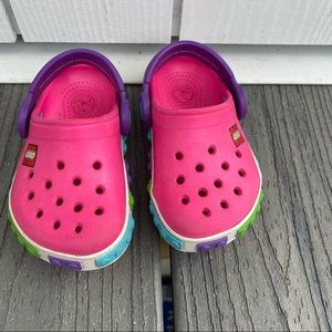 Pink lego crocs for baby size 4c